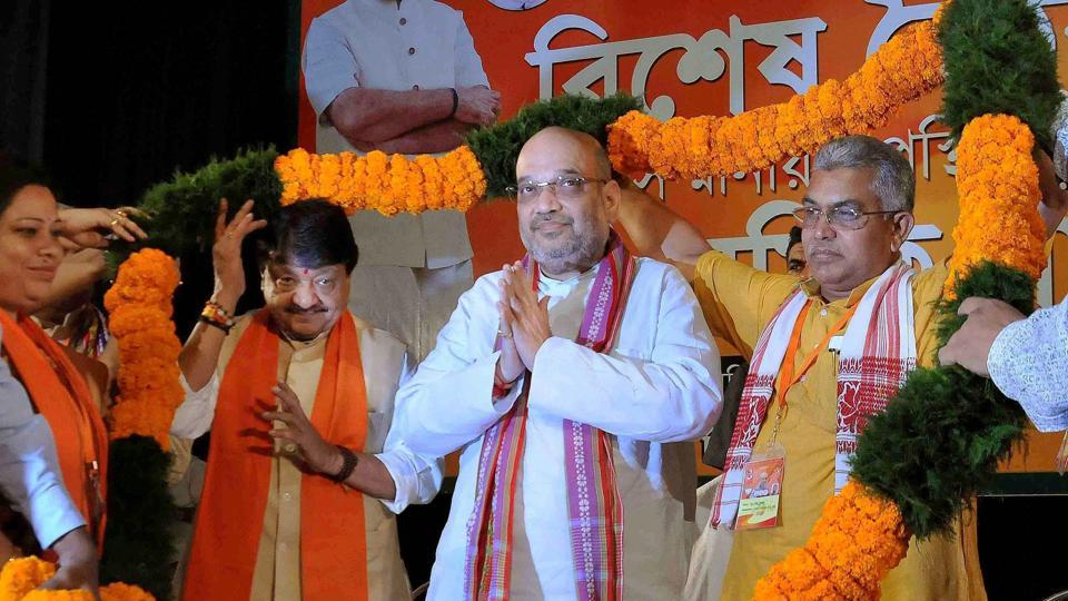 BJP National President Amit Shah being garlanded a during a party meeting at ICCR (Indian Council for Cultural Relations) in Kolkata.