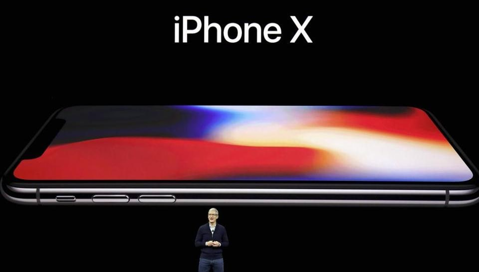 Apple CEO Tim Cook announces the new iPhone X at the Steve Jobs Theater.