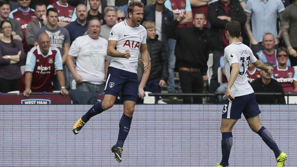 Tottenham's Harry Kane (left) celebrates after scoring his team's first goal, with teammate Ben Davies during the English Premier League soccer match between West Ham United and Tottenham Hotspur at the London Stadium in London, Saturday Sept. 23, 2017.