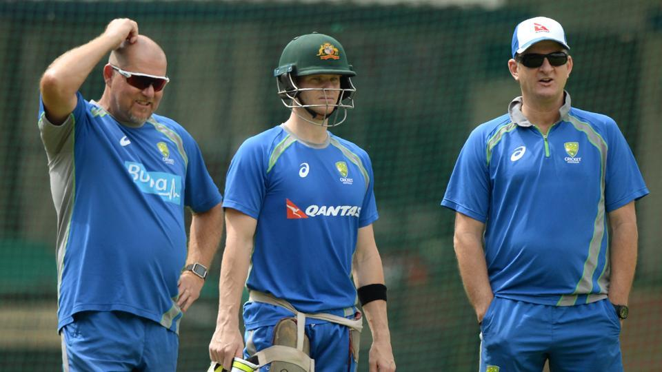 Australian captain Steven Smith (C) watches team mates along with selector Mark Waugh (R) and coach David Saker (L) during a training session at the Holkar Stadium in Indore on September 23, 2017.  (AFP)