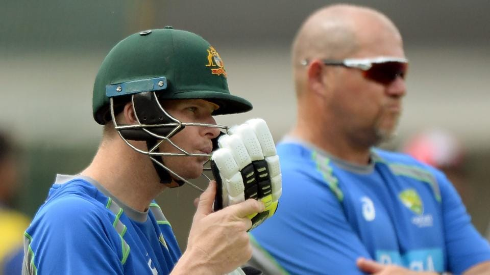 Australian captain Steven Smith (L) blows air to dry his gloves during a training session at the Holkar Stadium in Indore on September 23, 2017.  (AFP)