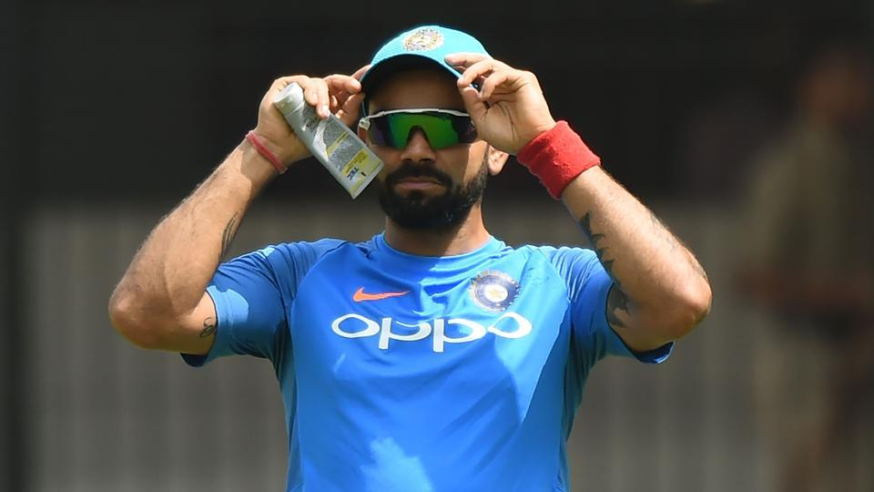 Indian cricket captain Virat Kohli watches teammates during a training session at the Holkar Stadium in Indore on September 23, 2017. Virat Kohli is on the verge of equalling MS Dhoni's record of most consecutive wins in ODI cricket.