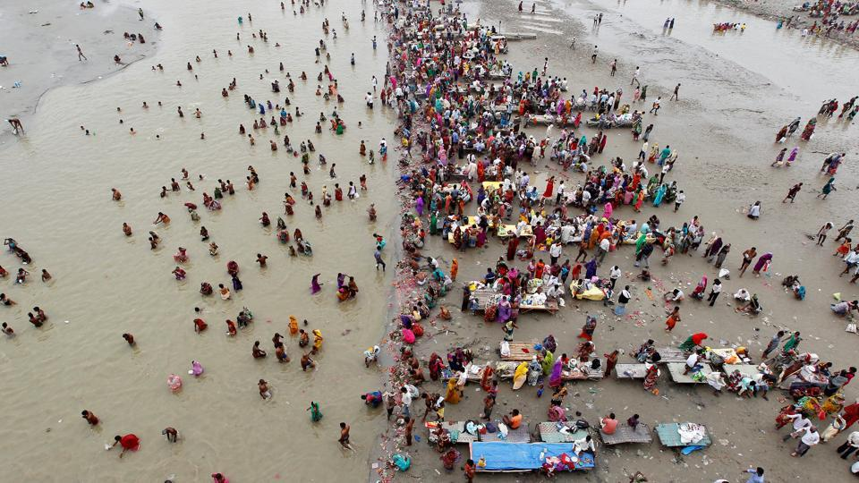 Devotees take a holy dip in the Ganges on the first day of Navratri, a festival of nine days when devotees worship Hindu goddess Durga, in Allahabad, India. (Jitendra Prakash / REUTERS)