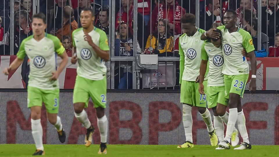 Wolfsburg's players celebrate their late equaliser against Bayern Munich at the Allianz Arena on Friday.