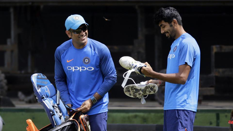 Dhoni and Jasprit Bumrah share a laugh at the practice session. (AP)