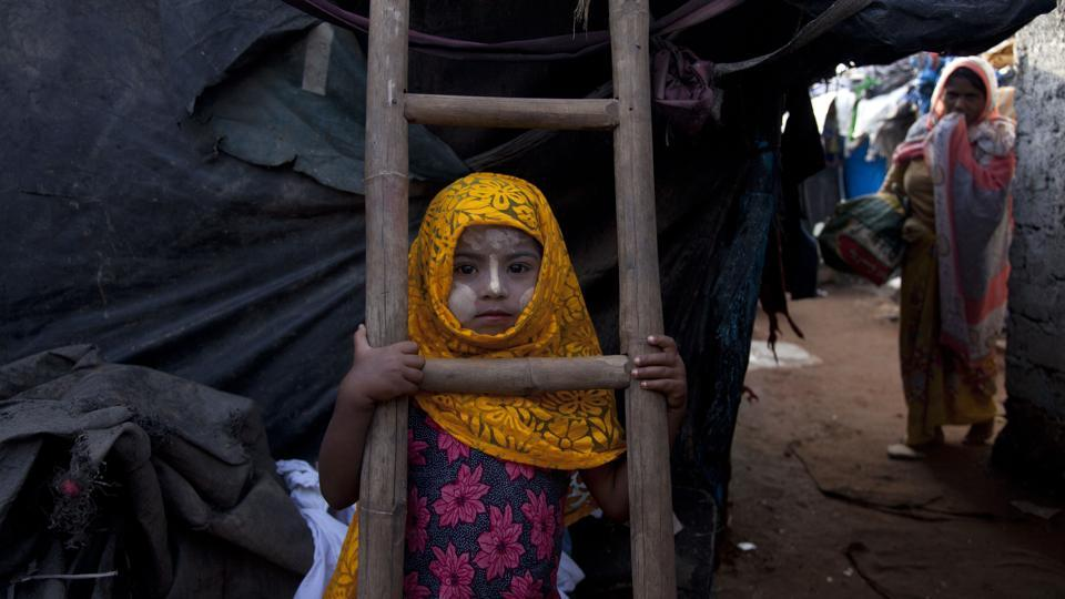 A Rohingya Muslim girl Yasmin Ara stands in front of her shanty at a camp for refugees in Hyderabad . India's government said Monday that it has evidence there are extremists who pose a threat to the country's security among the Rohingya Muslims who have fled Myanmar and settled in many Indian cities. India's Supreme Court was hearing a petition filed on behalf of two Rohingya refugees challenging a government decision to deport the ethnic group from India.  (Mahesh Kumar A / AP)