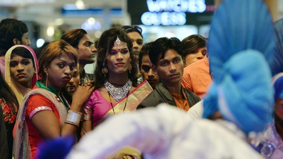Indian transgenders look at a performance during a 'Hijra Habba' event with the theme 'All citizens equal - Inclusion', at a shopping mall in New Delhi. (MONEY SHARMA / AFP)