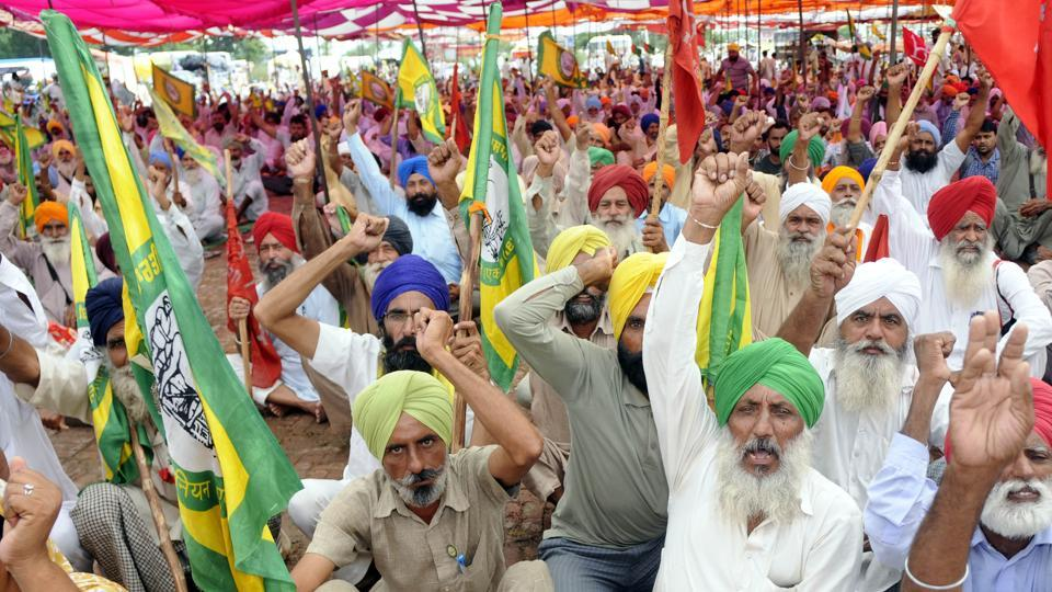 Farmer protesting at Mehmudpur village on the Patiala-Sangrur road on Saturday.