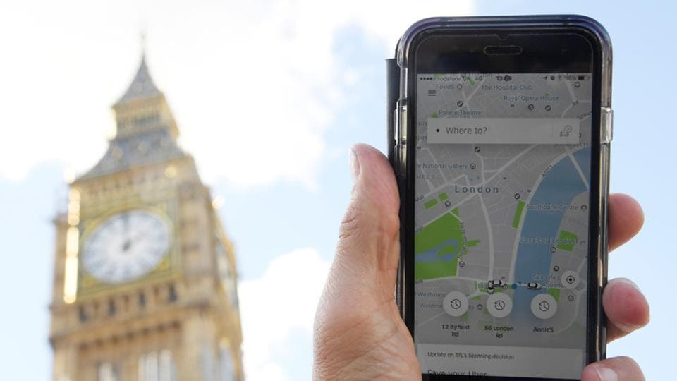 A photo illustration shows the Uber app on a mobile telephone, as it is held up for a posed photograph in central London, Britain September 22, 2017.