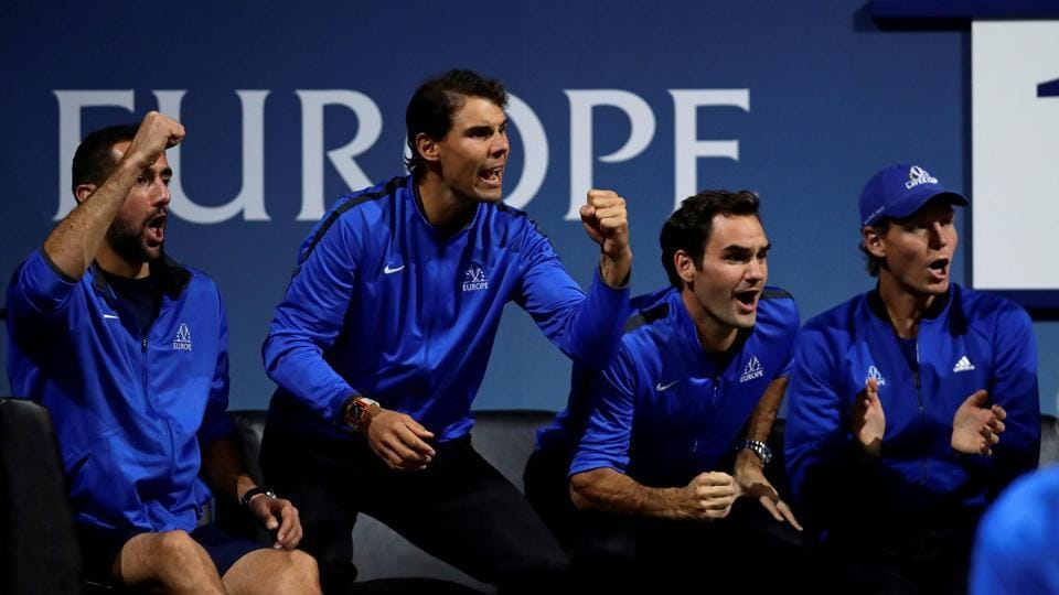Team Europe players cheer from the sidelines during one of Friday's singles matches.