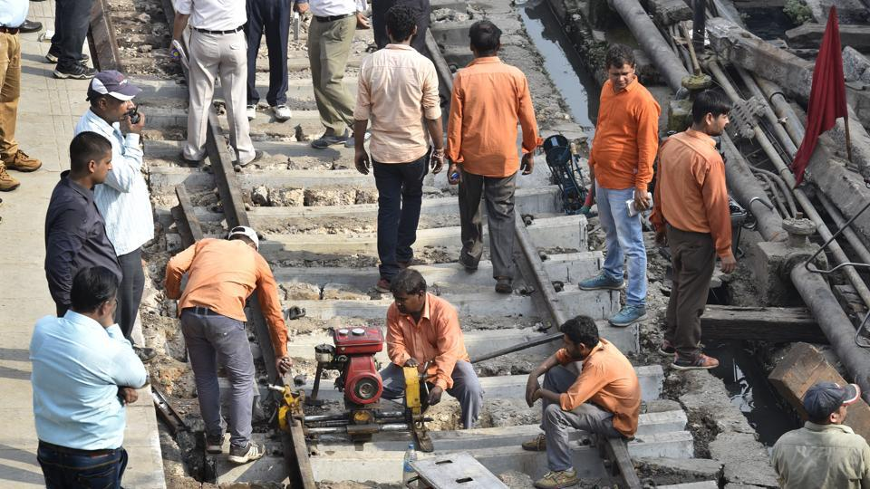 A file photo od repair work of railway track being carried out after last coach of Jammu Rajdhani Express train derailed in New Delhi on September 14.