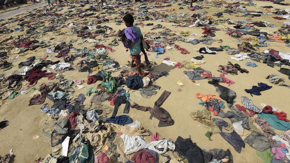 A Rohingya Muslim boy walks past discarded clothing on the ground at the Bhalukali refugee camp near Ukhia on September 16, 2017. According to the UN nearly 400,000 Rohingya have arrived in Bangladesh since August 25 after fleeing a military crackdown launched by Myanmar's military in response to attacks by Rohingya rebels.  (Dominique Faget  / AFP)