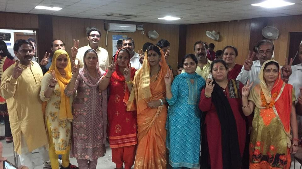 The winners at the  Mini Secretariat on Sunday evening after results were announced. Of 35 seats, independents win 21, BJP 13, INLD 1