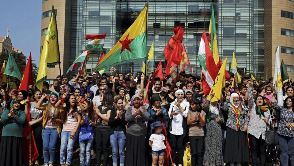 Supporters of the Kurdistan Workers' Party, known as the PKK, chant slogans as they take part in a demonstration demanding the release of Kurdish guerrilla leader Abdullah Ocalan, in front of the United Nations Headquarters in Beirut, Lebanon, Sunday, Sept. 24, 2017.