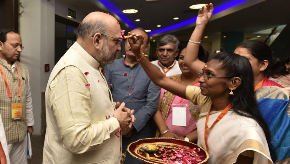 BJP president Amit Shah arrives to attend the BJP office bearers and national executive meetings in New Delhi on Sunday.