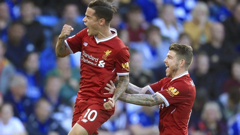 Liverpool's Philippe Coutinho, left, celebrates scoring his side's first goal against Leicester City.