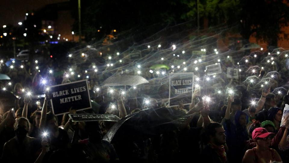 Demonstrators hold up their mobile phones as they continue to protest for a fourth day after the not guilty verdict in the murder trial of Jason Stockley, a former St. Louis police officer, charged with the 2011 shooting of Anthony Lamar Smith, who was black, in St. Louis, Missouri, U.S. (Joshua Lott  /  REUTERS)