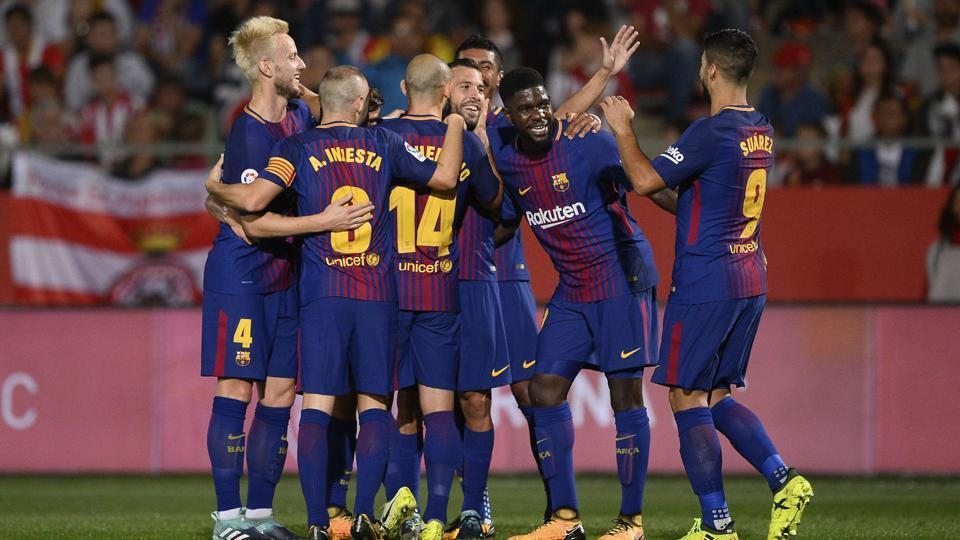 Barcelona players celebrate aftyer scoring during the Spanish league football match Girona FC vs FC Barcelona at the Montilivi stadium in Girona on Saturday.