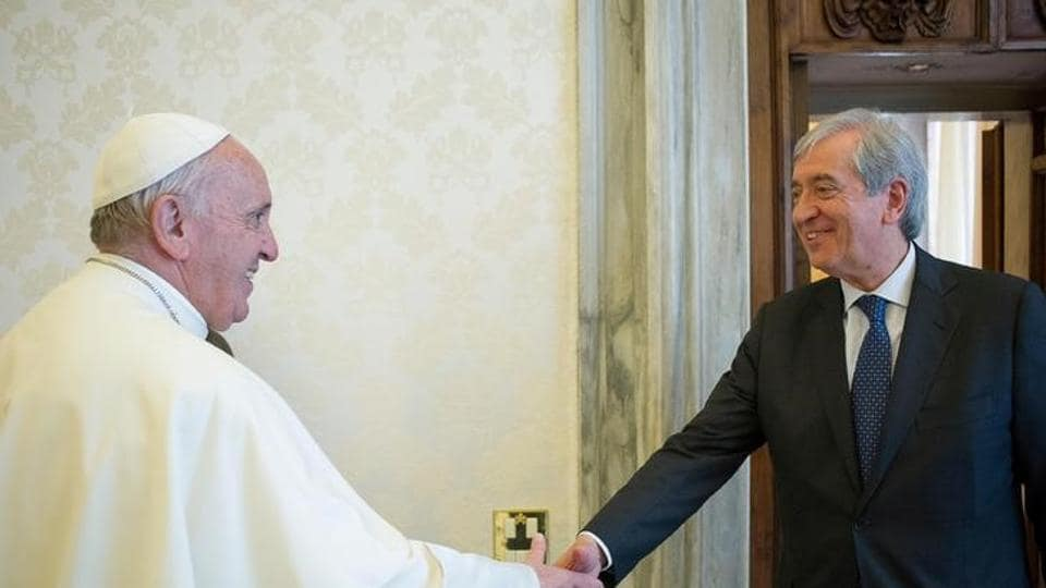 Pope Francis is greeted by Libero Milone (R), the Vatican's auditor general who resigned in June, during a meeting at the Vatican.