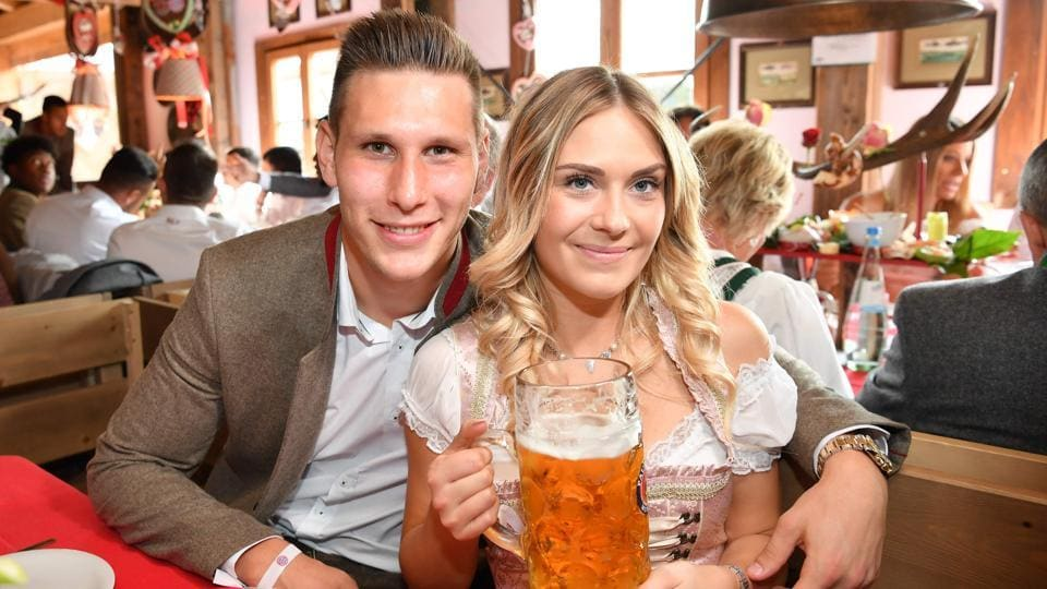Bayern Munich's German defender Niklas Suele and his girlfriend Melissa Halte pose during the traditional visit of FC Bayern Munich to the Oktoberfest beer festival in Munich, Germany.  (AFP)