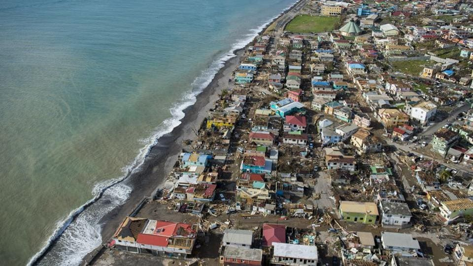 An aerial view of Roseau, capital of the Caribbean island Dominica, shows destruction on September 21, 2017, three days after passage of Hurricane Maria. Dominica, located near the French islands of Martinique and Guadeloupe, has been almost completely cut off from the world since the impact of the hurricane. (Lionel Chamoiseau / AFP)