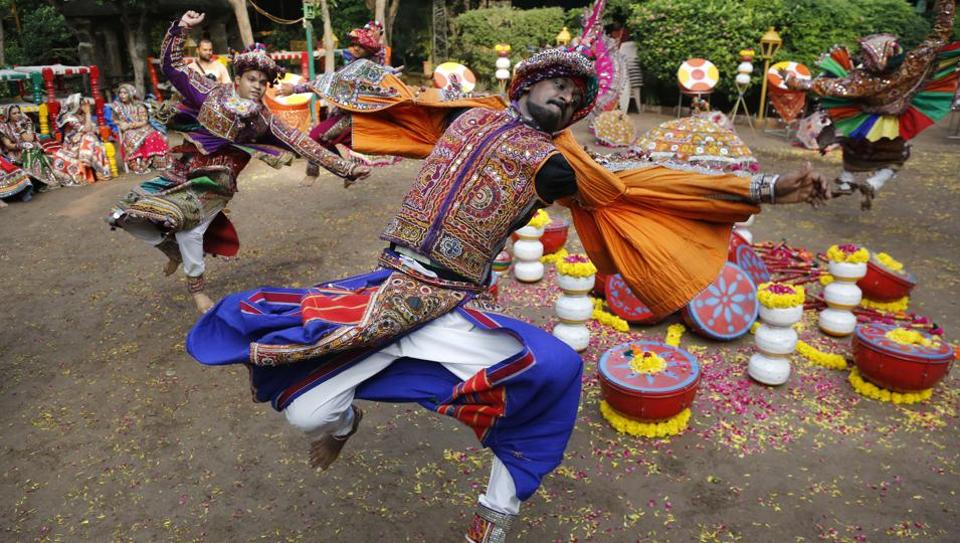 Performers wearing traditional attire practice Garba, a dance of Gujarat state, ahead of Navratri festival in Ahmadabad.