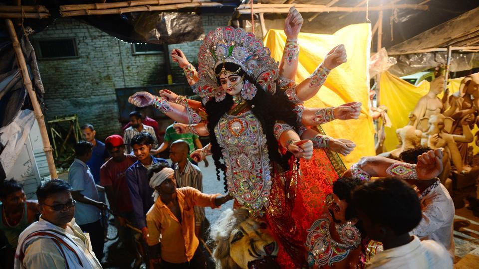 Durga Puja,Durga idol immersion,Basirhat