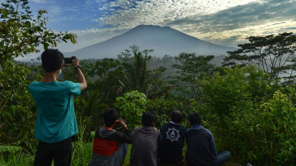 People visit Mount Agung in Karangasem on the Indonesian resort island of Bali after authorities raised alert levels for its eruption.