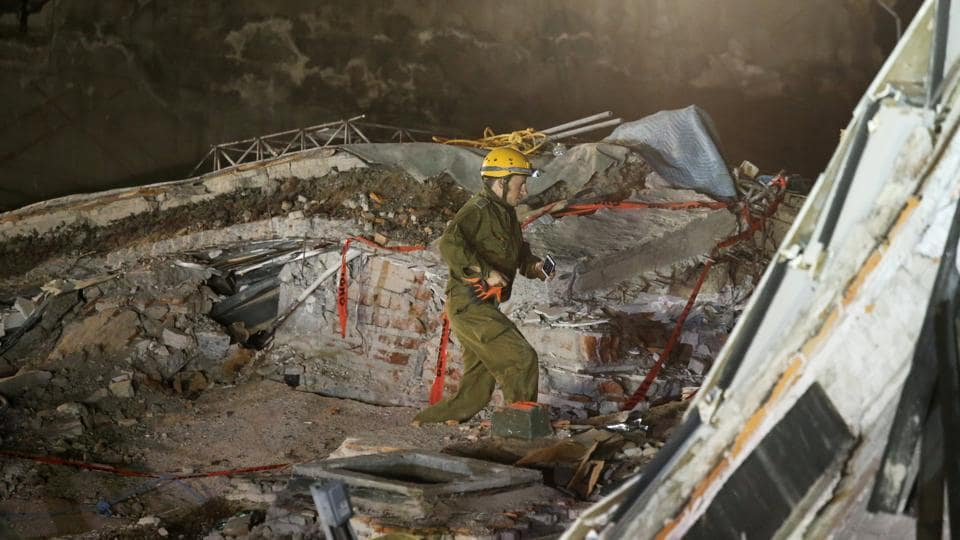 Rescue team searches for survivors in the rubble of a collapsed building after an earthquake in Mexico City.