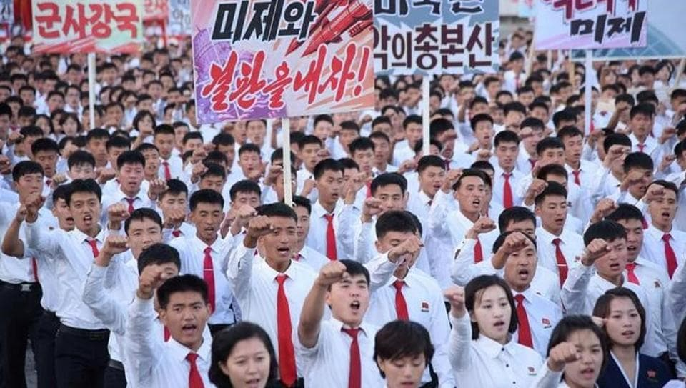 An anti-US rally at Kim Il Sung Square is seen in this September 23, 2017 photo released by North Korea's Korean Central News Agency (KCNA) in Pyongyang . Placards read (L-R)