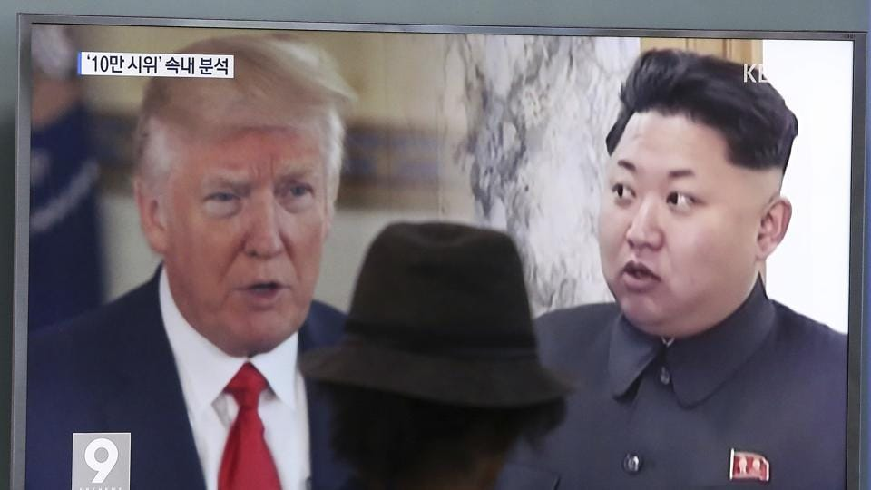 In this Aug. 10, 2017, file photo, a man watches a TV screen showing US President Donald Trump (L) and North Korean leader Kim Jong Un during a news program at the Seoul Train Station in Seoul, South Korea.