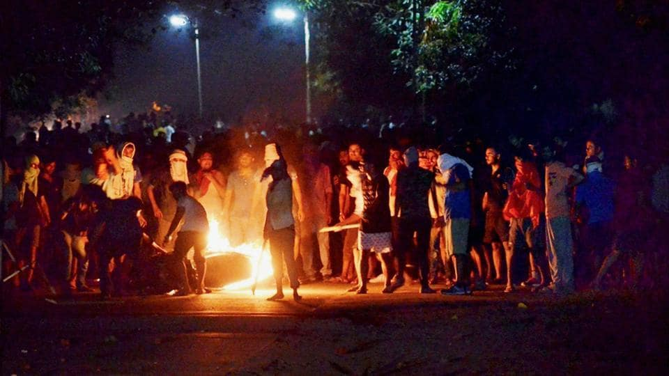 A bike in flames during clashes between the students and police at Banaras Hindu University in Varanasi.