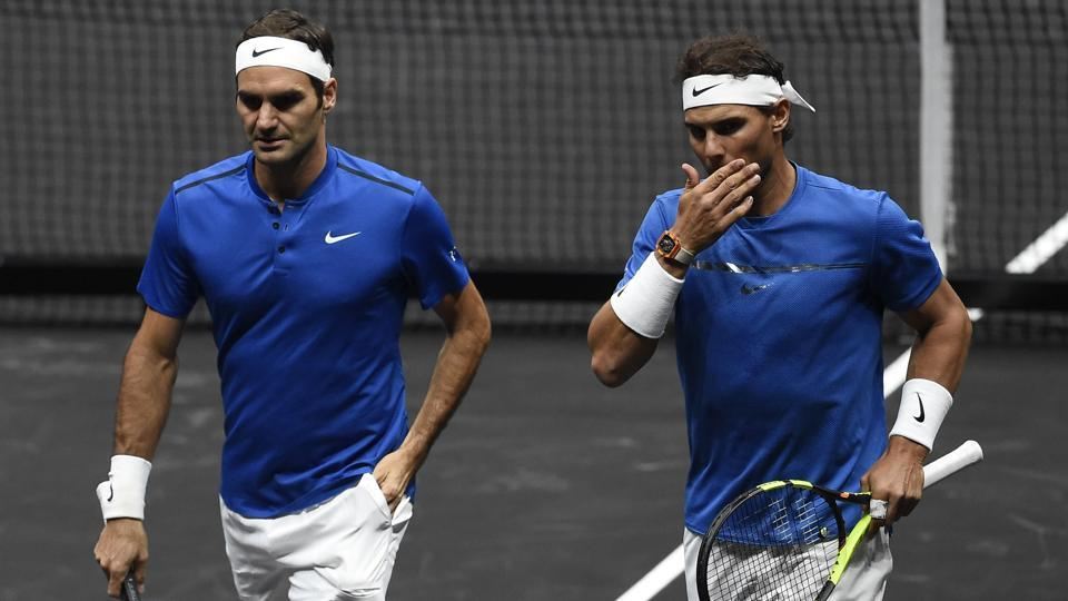 Roger Federer and Rafael Nadal of Team Europe talk during their match against Sam Querrey and Jack Sock at Laver Cup.