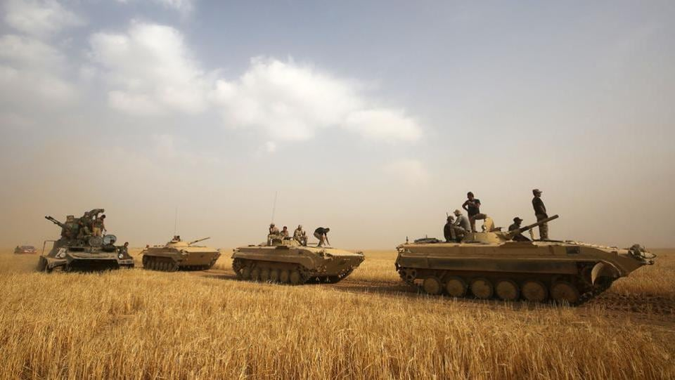Iraqi forces advance towards the city of al-Sharqat on September 21, 2017, where Iraqi forces backed by Hashed al-Shaabi (Popular Mobilisation) paramilitaries are preparing to retake the jihadist-held city of Hawijah in the province of Kirkuk, 300 kilometres (185 miles) northwest of Baghdad.  (AFP)