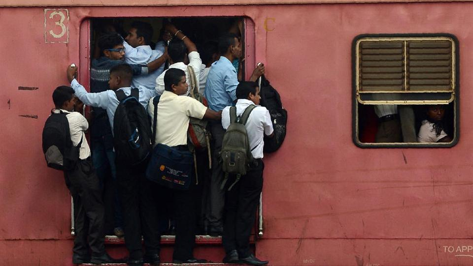 Passengers travel in a train in Colombo on September 19, 2017. (AFP)