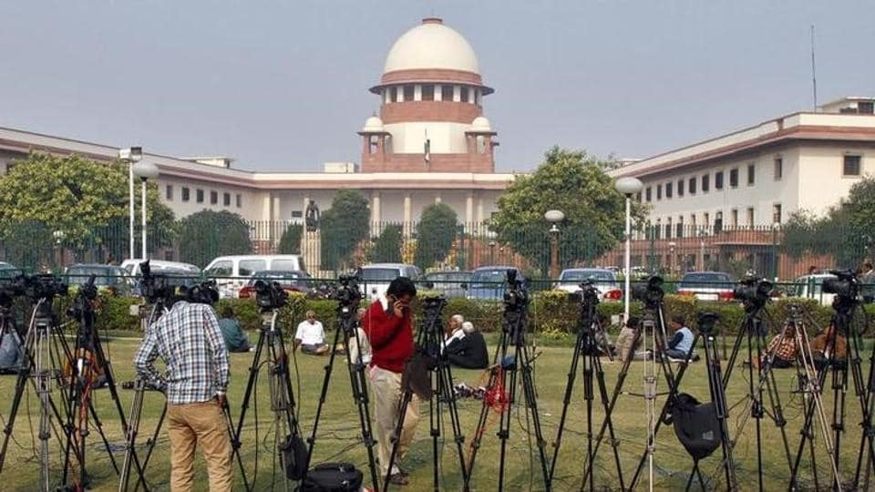 Tripods of television crew in front of the Supreme Court building in New Delhi.