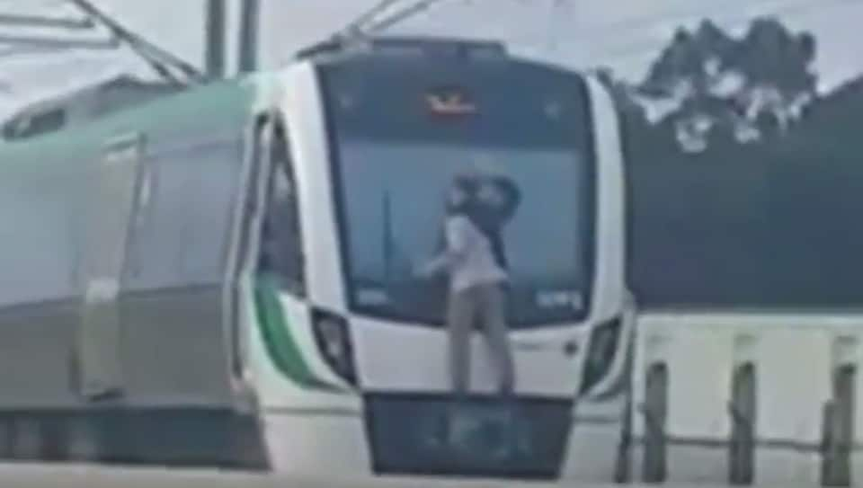 A man was arrested after he climbed a train and clung to its windscreen wiper in Perth.