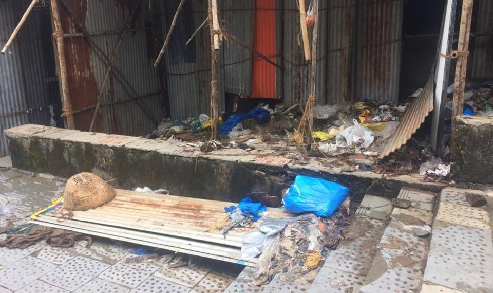 Garbage rots at an empty stall on Thursday.