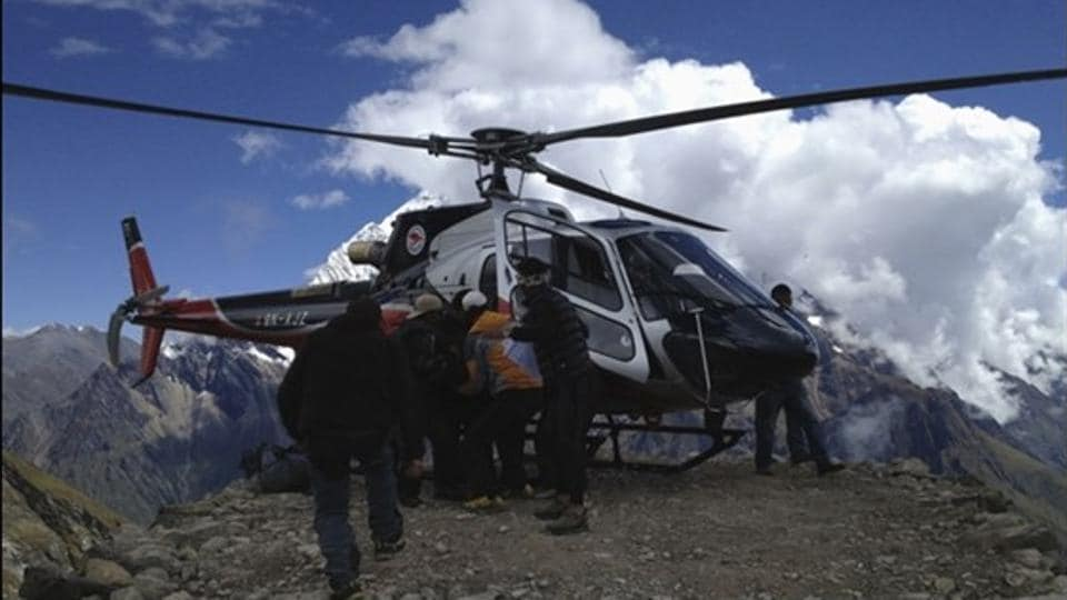 File photo of rescue team members carrying a victim of an avalanche at Mount Manaslu base camp in September 23, 2012.