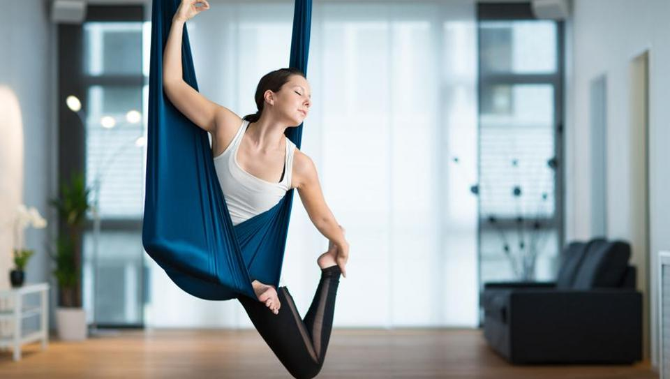 Anti-gravity yoga or aerial yoga combines the traditional yoga poses, Pilates and dance with the use of a hammock.