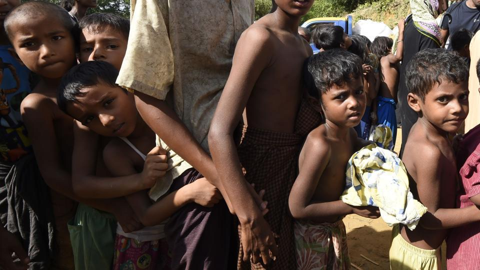 Children line up to collect relief supplies at the Kutupalong refugee camp for Rohingyas in Bangladesh on September 22.