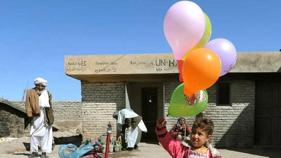 An Afghan girl holds balloons during celebrations of Nowruz, the Afghan new year in Herat.  Afghanistan is a resource-rich country populated by driven and talented people. Its citizens have had to innovate to resolve problems through decades of conflict and meet the needs of their communities.