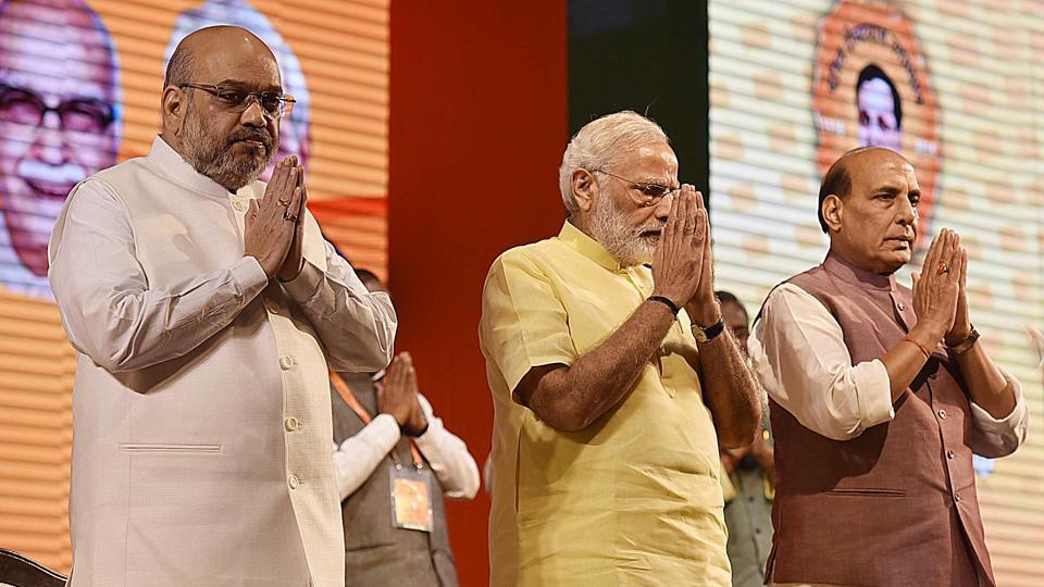 BJP party president Amit Shah, Prime Minister Narendra Modi, home minister Rajnath Singh at the BJP national executive meeting at Talkatora Stadium in New Delhi on Monday.