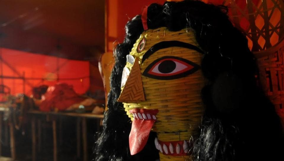 Preparations for Durga Puja celebrations at the pandal at Jalvayu Vihar, Sector 25. The theme is 'Shilp Kutir'.