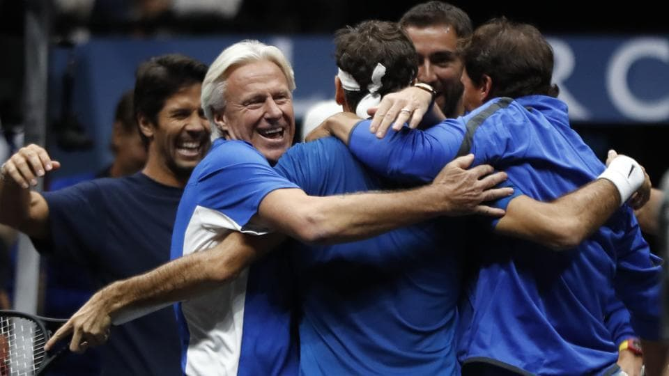 Roger Federer, center, celebrates with teammates and team's captain Bjorn Borg, left, after defeating World's Nick Kyrgios. (AP)