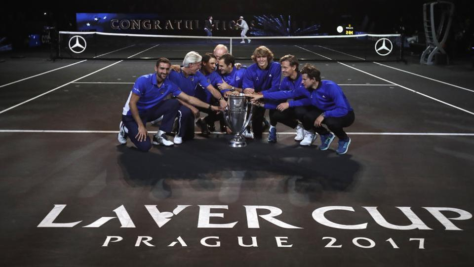 Team Europe together with tennis legend Australian Rod Laver pose for a photograph with the trophy. (AP)