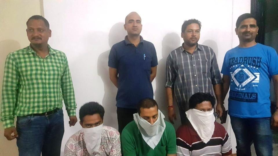 The accused (sitting) arrested in connection with the fake job racket in Dehradun.