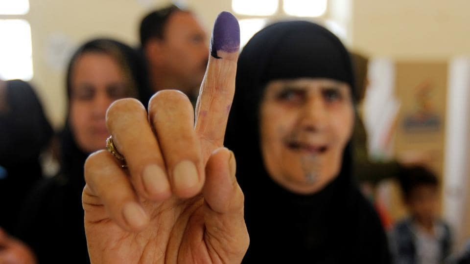 A woman shows her ink-stained finger after casting her vote in the Kurdish independence referendum in Kirkuk, Iraq on September 25, 2017. Iraqi Kurds took to the ballot in defiance of Baghdad which has warned of 'measures' to defend Iraq's unity and threatened to deprive their region of lifeline oil revenues. Initial results, expected to be announced 24 hours after polls close predict an overwhelming 'Yes' outcome but Kurdish officials have said there are no plans for an immediate declaration of independence. (Ako Rasheed / REUTERS)