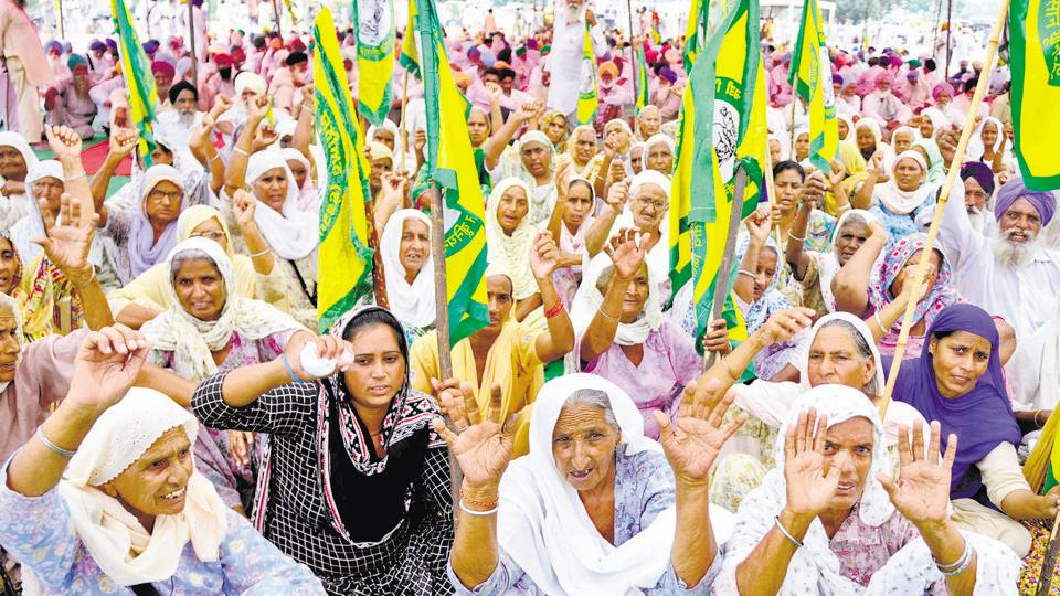 Members of the Bharatiya Kisan Union holding a Protest against the state government on the Chandigarh-Bhatinda road.