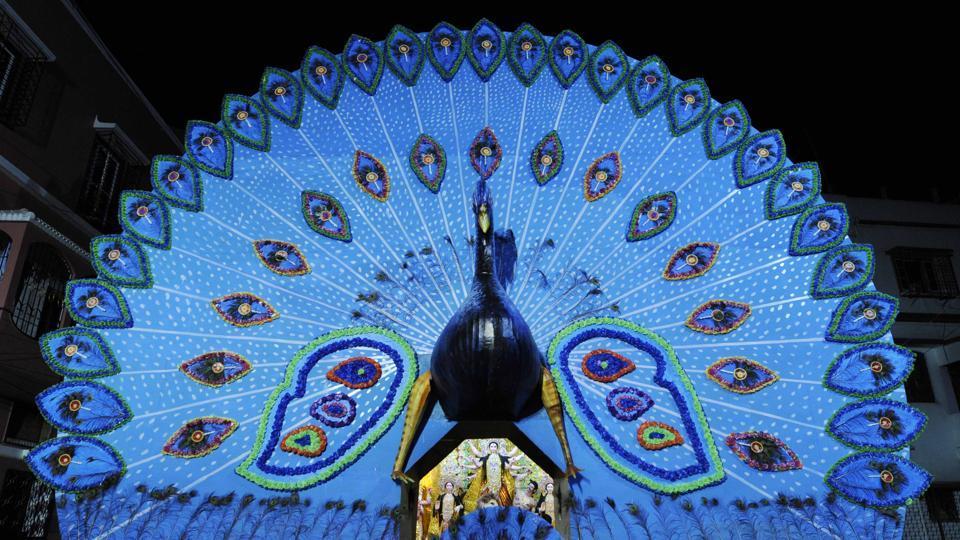At the Monotosh Smritisangha Durga Puja in Rashbehari, South Kolkata, India's national bird, the peacock, finds itself central to the pandal's decorative aesthetic. (Samir Jana / HT Photo)